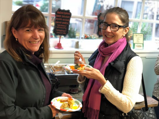 Customers taste the Thanksgiving menu offerings at Curb Side Casserole's Holiday Open House.