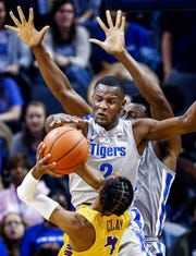 Memphis defender Alex Lomax (top) blocks the shot of Tennessee Tech guard Jr. Clay (bottom) during action at the FedExForum in Memphis Tenn., Tuesday, November 6, 2018.