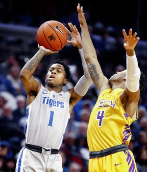 Memphis guard Tyler Harris (1) puts up a shot in front of Tennessee Tech defender Jr. Clay during Tuesday's game. Harris was 0-for-6 on the night.