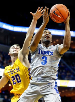 Memphis guard Jeremiah Martin (right) drives the lane against Tennessee Tech defender Hunter Vick  (left) during action at the FedExForum in Memphis Tenn., Tuesday, November 6, 2018.