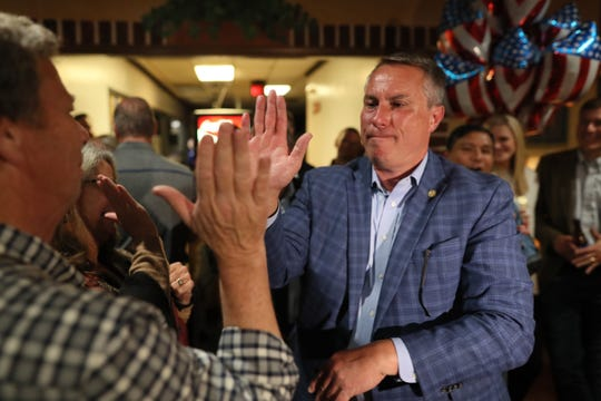 Germantown Mayor Mike Palazzolo celebrates with his supporters as he finds himself in a lead to retain his position during an election night watch party at Garibaldi's Pizza Tuesday, Nov. 6, 2018.