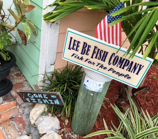A sign in front of Lee Be Fish Company, Marco Island.