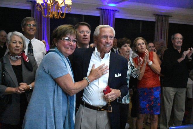 Winner Erik Brechnitz celebrates his victory with his wife Nancy. Marco Island voters elected Erik Bredhnitz and Sam Young along with re-electing incumbent Victor Rios for four year temrs on the Marco Island City Council Tuesday evening.