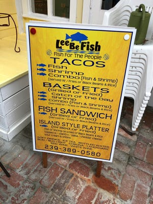 The menu board outside Lee Be Fish Company, Marco Island.