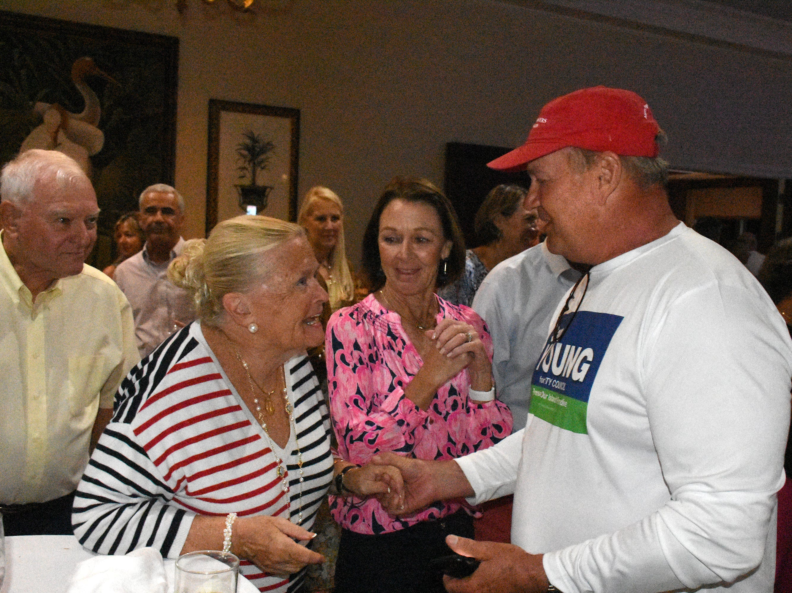 Winner Sam Young celebrates his win. Marco Island voters elected Erik Bredhnitz and Sam Young along with re-electing incumbent Victor Rios for four year temrs on the Marco Island City Council Tuesday evening.