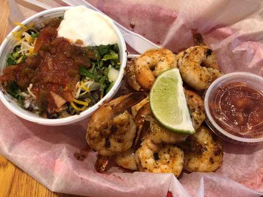 The grilled shrimp basket with black beans and rice from Lee Be Fish Company, Marco Island.