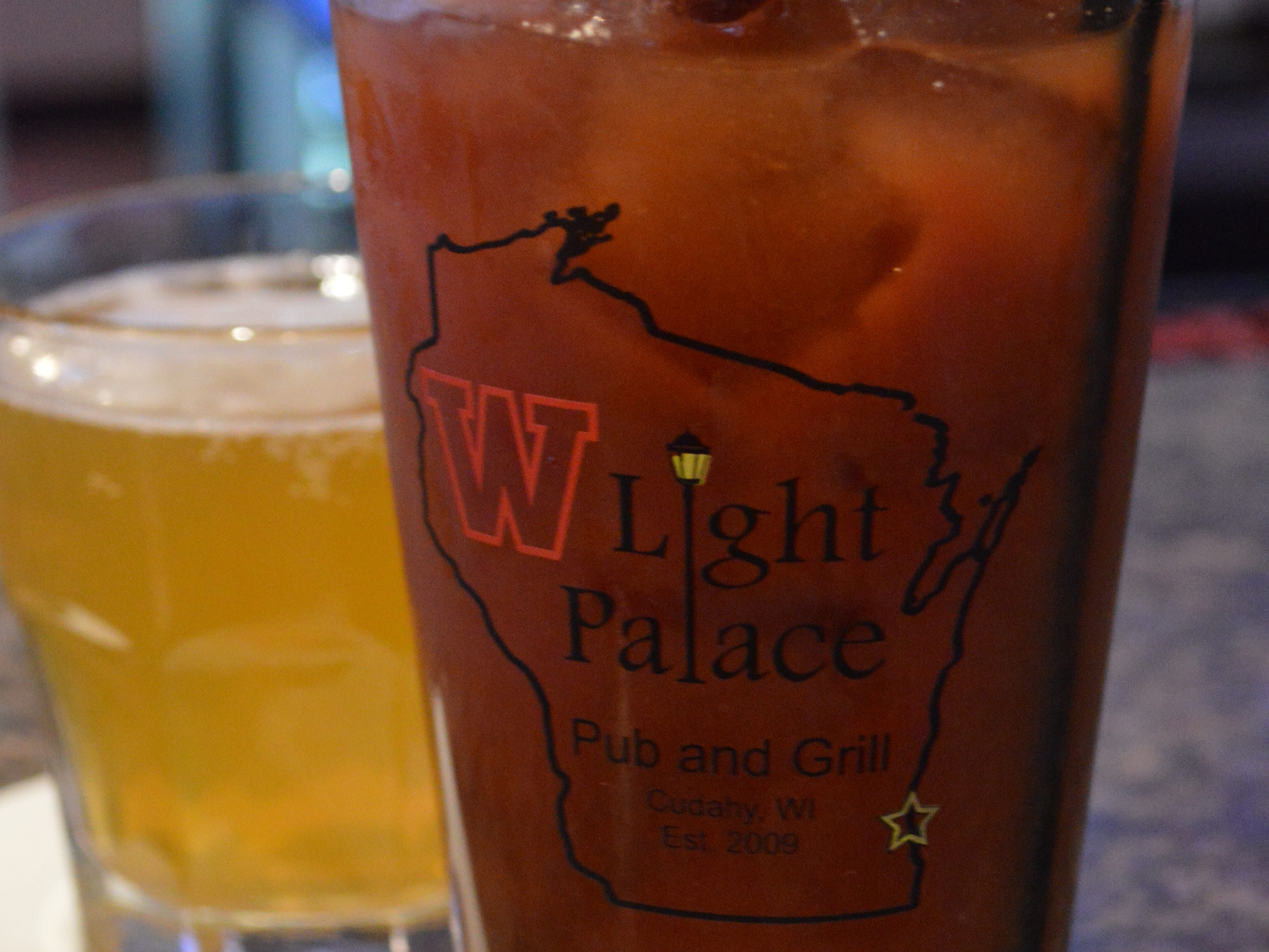 Light Palace's most popular drink is its bloody mary, which is made from scratch. It's garnished with a lime, olive, pickle, pickled Brussel sprout, pickled mushroom, cheese cube and beef stick. It costs $6 Monday through Friday, and $5 on Saturday and Sunday.