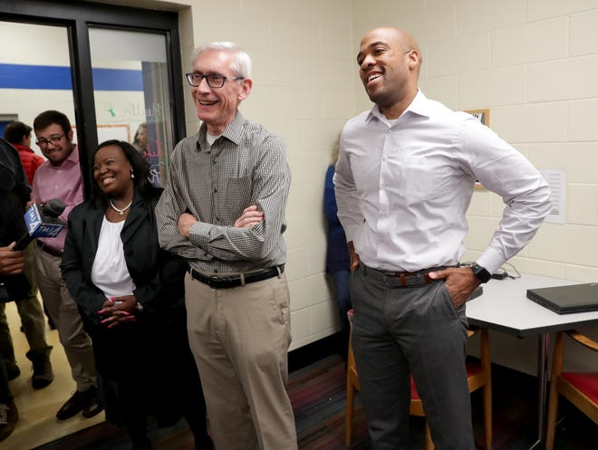 Gov.-elect Tony Evers (center), Lt. Gov.-elect Mandela Barnes and state Rep.-elect Shelia Stubbs (D-Madison) laugh as they tour the Boys & Girls Club of Dane County in Madison.
