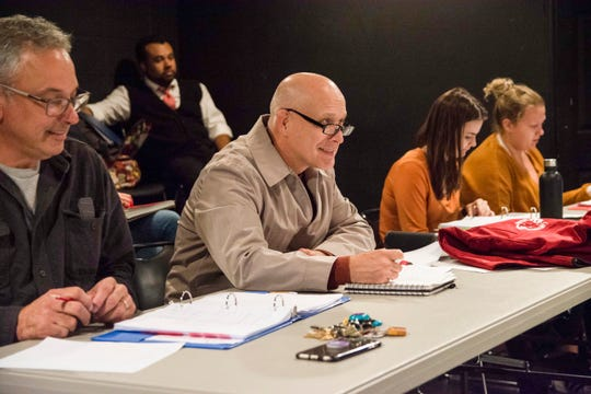 """Carthage College theater professor Herschel Kruger (left) and playwright Eric Simonson (second from left) enjoy a rehearsal of Simonson's opioid drama """"Up and Away."""" To Simonson's left, students Lindsey O'Connor and Sami Salmi check their notes. In the background, Jesus Matta observes."""