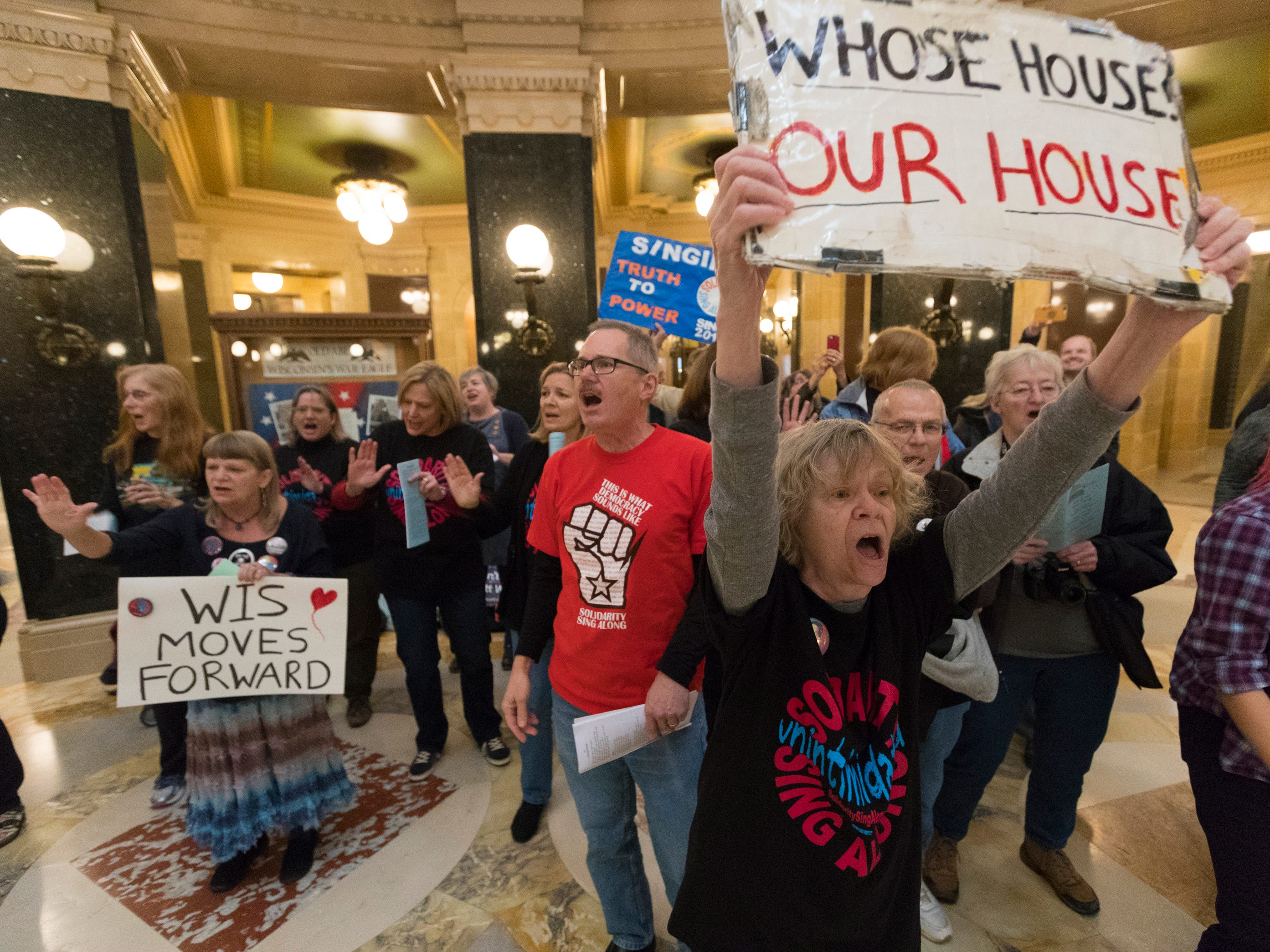 About 120 people associated with the Solidarity Singers belt out songs while celebrating the defeat of Republican Gov. Scott Walker during the lunch hour at the Capitol in Madison. Since 2011, a group of singers has gathered on most weekdays at noon to protest Walker and Republican lawmakers.