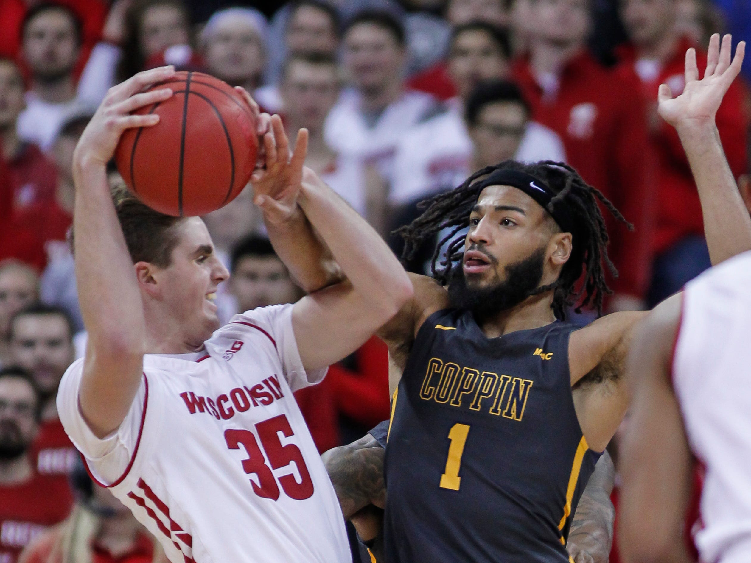 Wisconsin's Nate Reuvers drives on Coppin State's Chad Andrews-Fulton.