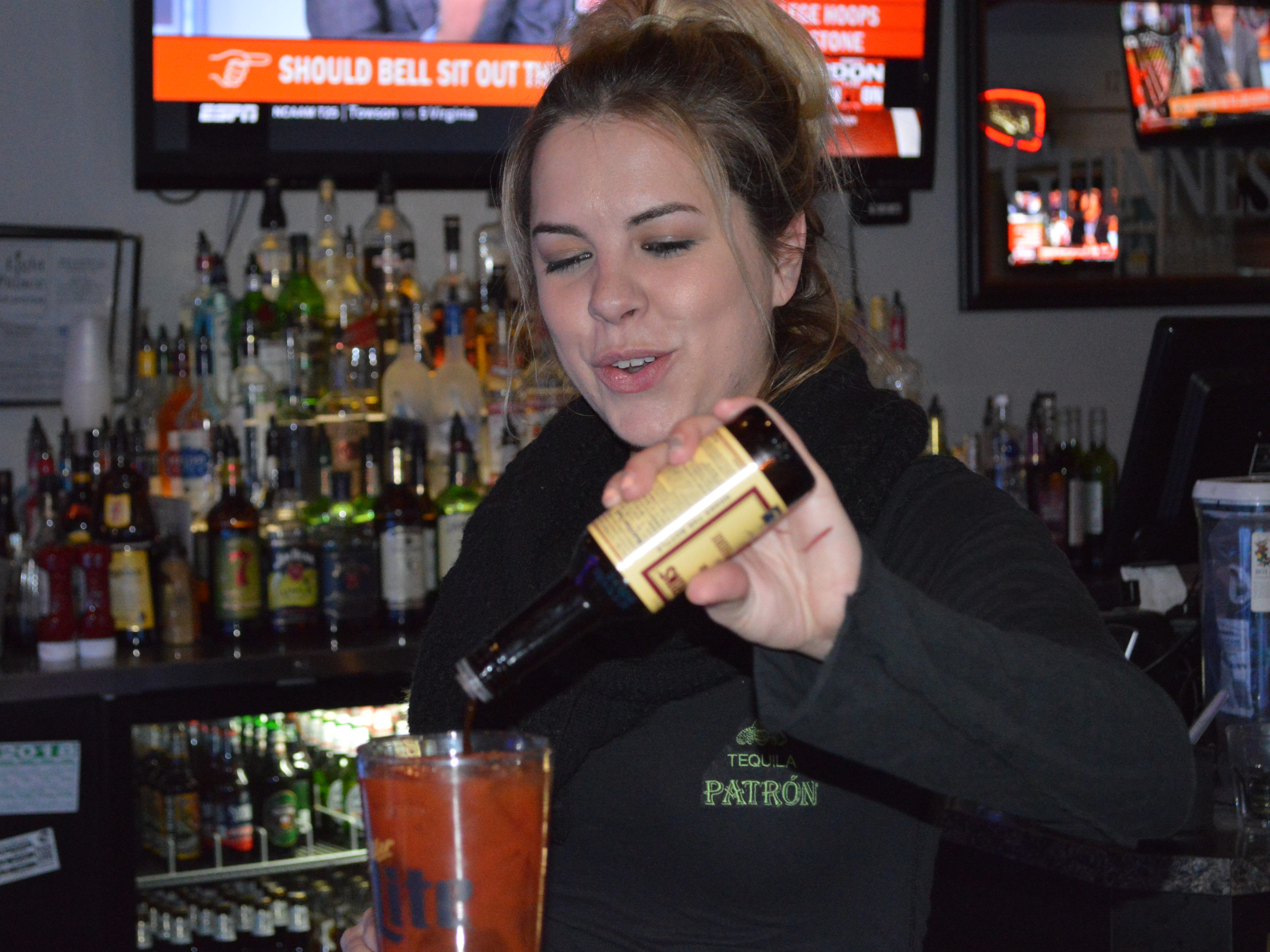 """Bartender Arja Walker said she has worked at many bars, but Light Palace feels """"homey."""""""