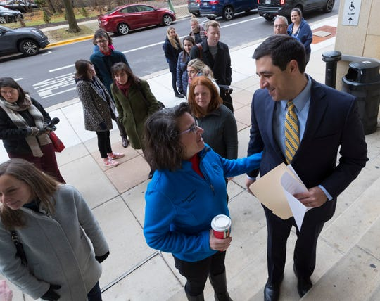 Attorney General-elect Josh Kaul (right) talks to supporters after claiming victory during a news conference at the Dane County Courthouse in Madison.