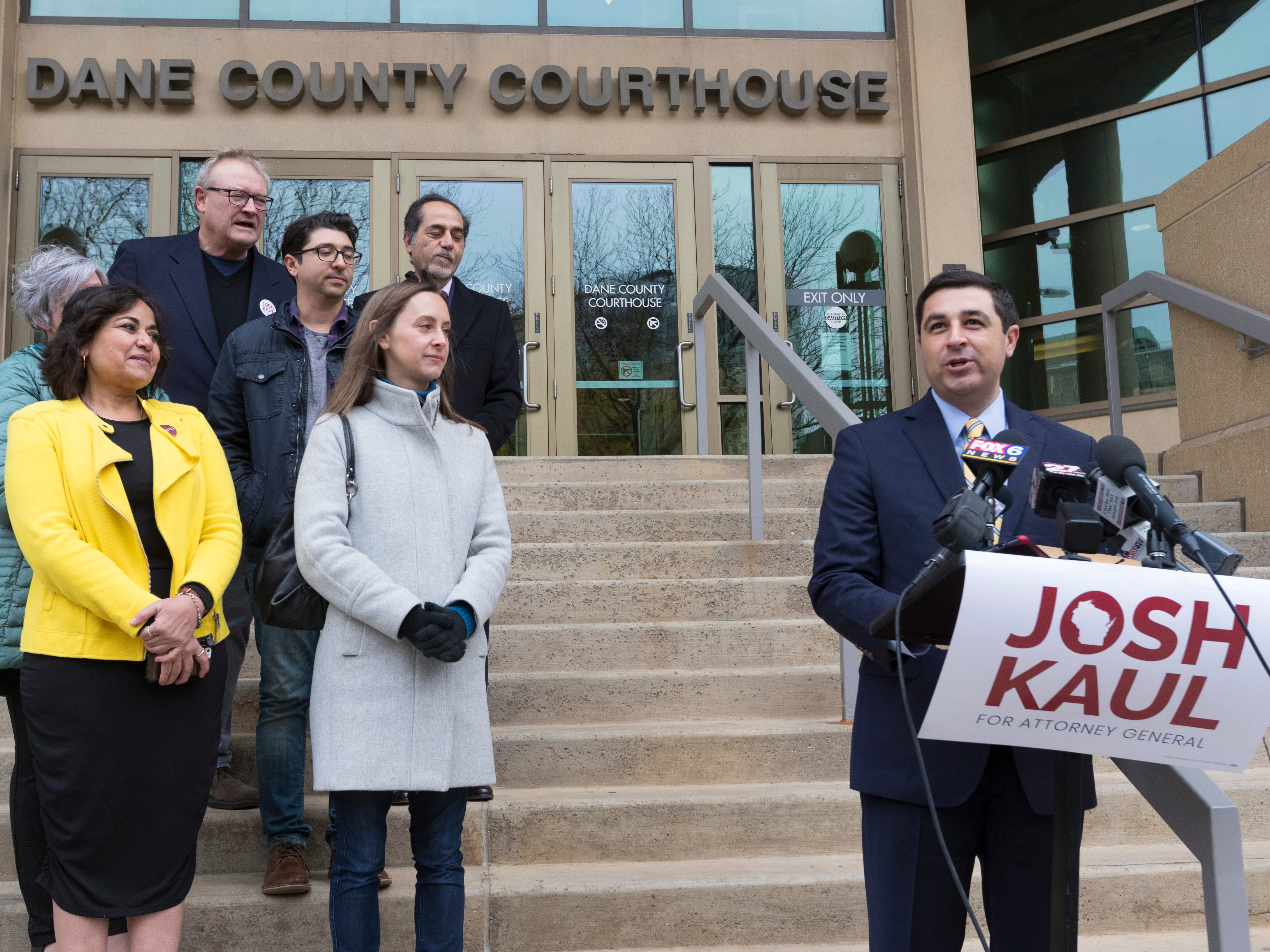 Democrat Josh Kaul (right) claims victory in the attorney general's race during a news conference at the Dane County Courthouse in Madison.