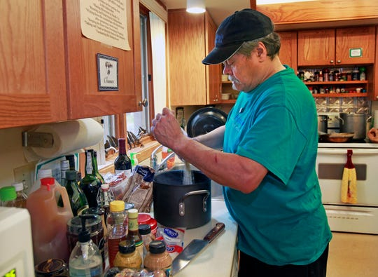Steve Paradowski pours barley in a pot for a dish he's preparing as part of a full Oktoberfest meal at Kathy's House in Wauwatosa. The chef volunteers his time at the hospital guesthouse.