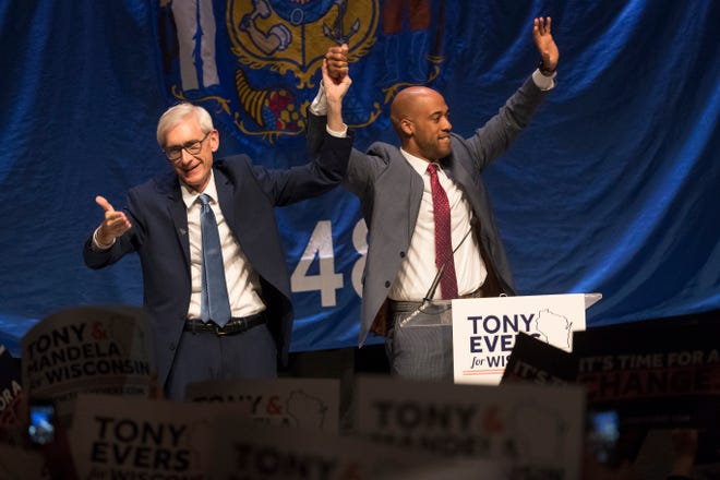 Democratic candidate for governor Tony Evers (left) and lieutenant governor candidate Mandela Barnes celebrate defeating Gov. Scott Walker, the No. 1 goal for state Democrats for eight years.