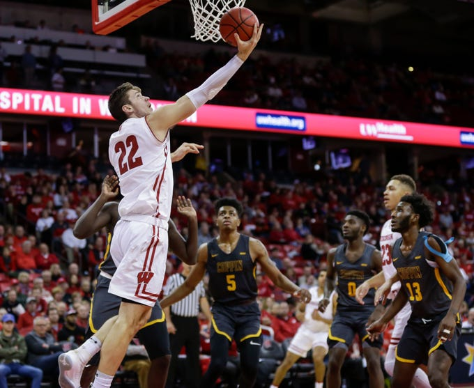 Wisconsin's Ethan Happ shoots a reverse layup after getting past the Coppin State defense