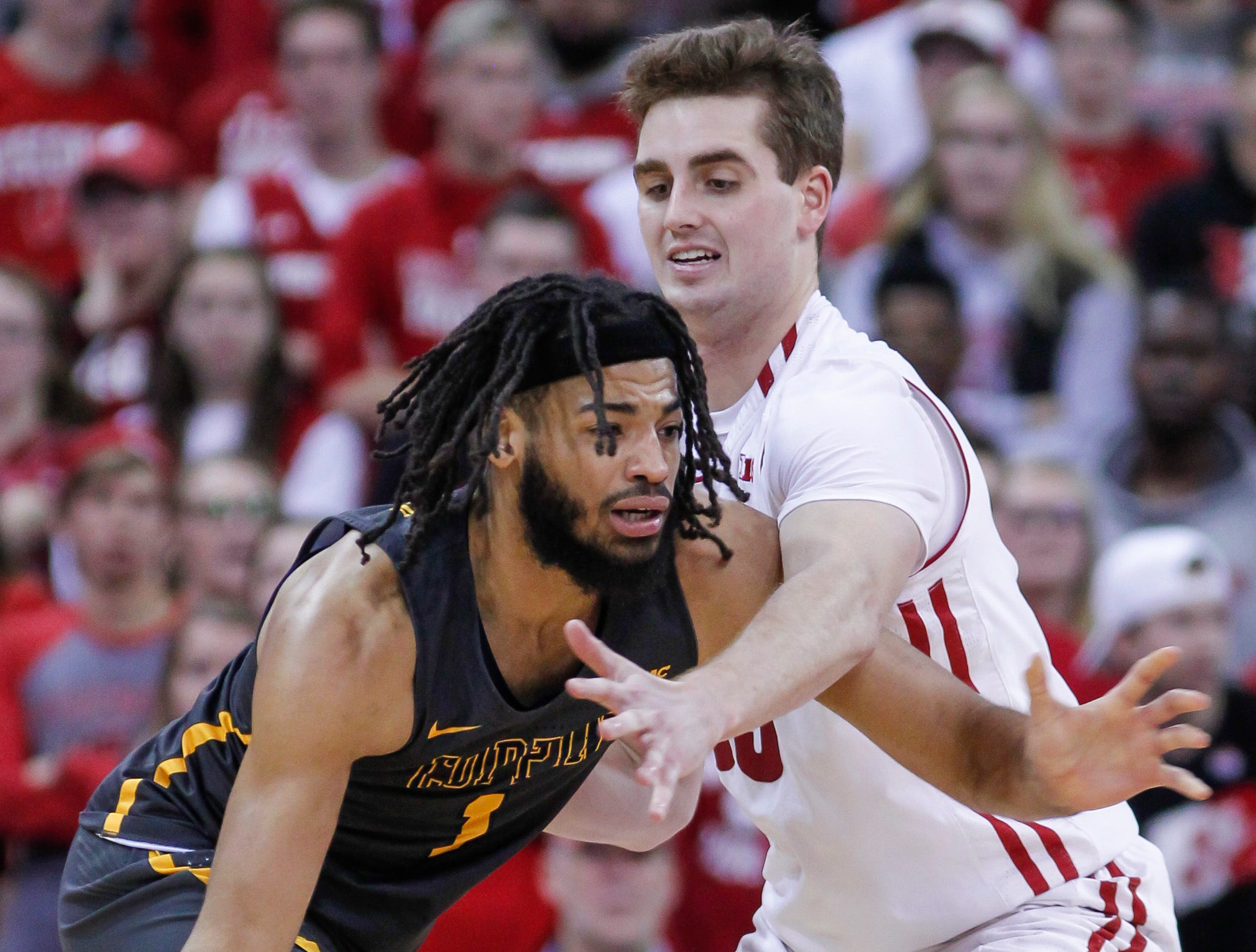 Wisconsin's Nate Reuvers reaches in on Coppin State's Chad Andrews-Fulton