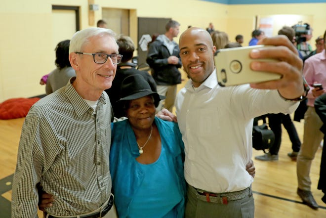 Gov.-elect Tony Evers (left) and Lt. Gov.-elect Mandela Barnes take a selfie with Linda Hoskins, the mother of state Rep.-elect Shelia Stubbs (D-Madison) after they visited the Boys & Girls Club.