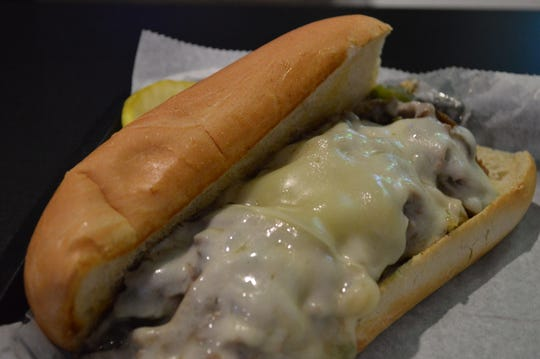 John Schulz, owner of Light Palace Pub and Grill, said his favorite menu item is the Philly cheesesteak, which is $7.95. It has steak, cheese, grilled onions, mushrooms, green peppers, mozzarella and provolone. It's served on a grilled bun and comes with a side.