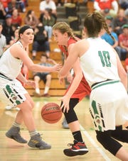 Norfork's Kynzie Rangel drives between Valley Springs' Bailey Bryant and Bethany Richardson on Tuesday night.