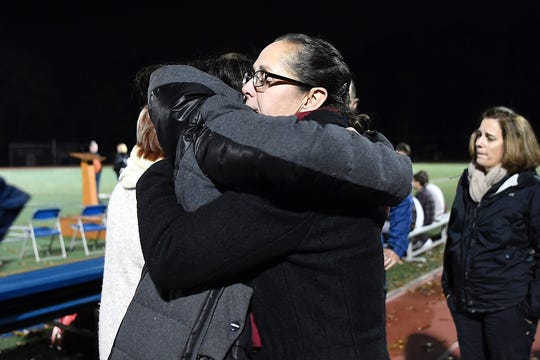Aleksandra Kolding, mother of 15-year-old Thomas Kolding, hugs a friend before holding a vigil for her son on Wednesday, Nov. 7, 2018. Thomas, of Mountain Lakes, went missing the night before Halloween.
