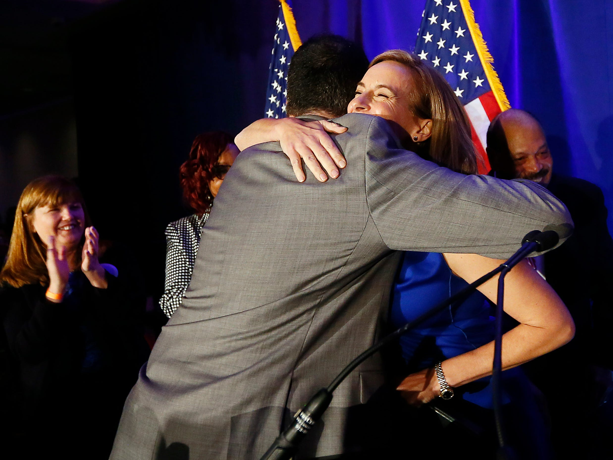 Mikie Sherrill gives a hug to Morris County Democratic Chairman Chip Robinson before she made her acceptance speech, winning for the Democrats a seat held by Republicans for more than 30 years. Sherrill defeated Republican candidate, state Assemblyman Jay Webber in the 11th District.