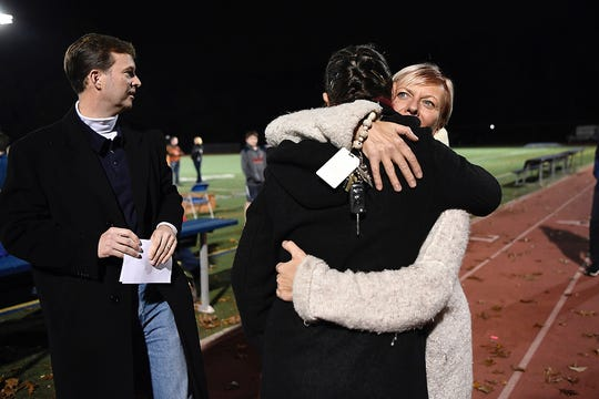 Thomas' father Nicolai Kolding looks on as mother Aleksandra hugs Terri Hammer, a kindergarten teacher in Mountain Lakes, before holding a vigil for Thomas on Wednesday, Nov. 7, 2018.