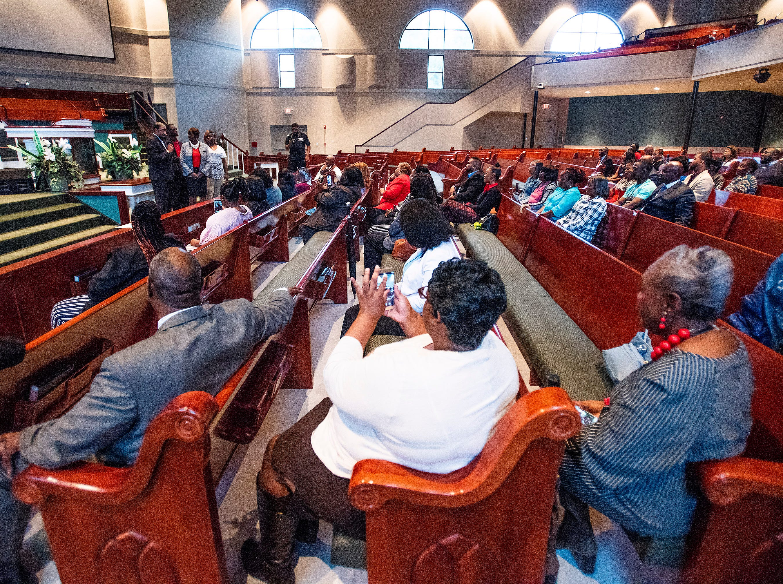 A crowd looks on during the swearing-in ceremony of Representative Tashina Morris at Freewill Baptist Church in Montgomery, Ala., on Wednesday November 7, 2018. Morris is Montgomery's first black female legislator.