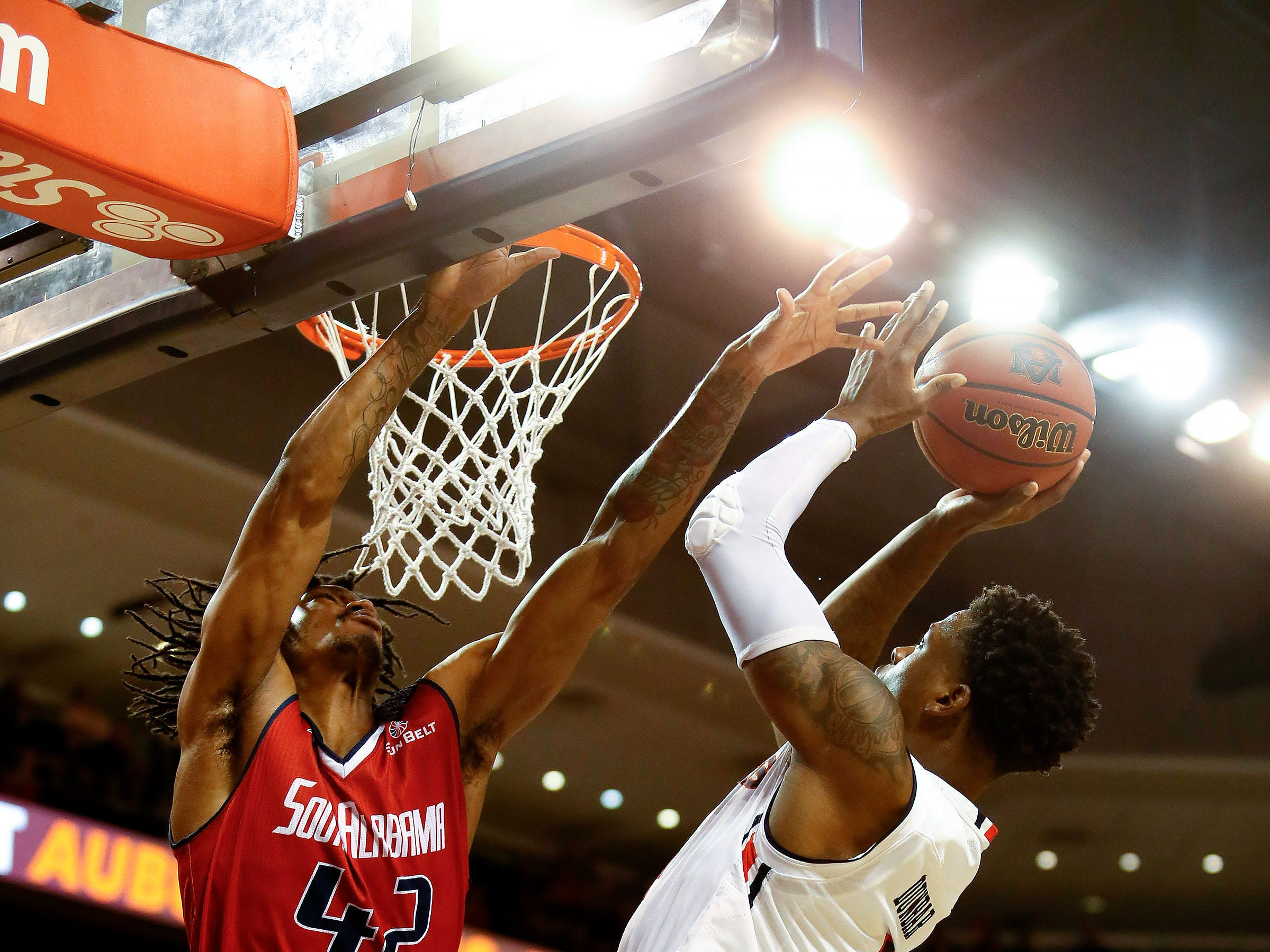 Nov 6, 2018; Auburn, AL, USA; Auburn Tigers guard Malik Dunbar (4) goes for a shot as South Alabama Jaguars forward Trhae Mitchell (42) defends during the second half at Auburn Arena. Mandatory Credit: John Reed-USA TODAY Sports