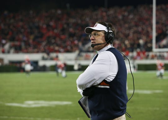 Auburn head coach Gus Malzahn looks on during a game against Georgia at Sanford Stadium in Athens, Ga., on Nov. 15, 2014. Georgia won 34-7.