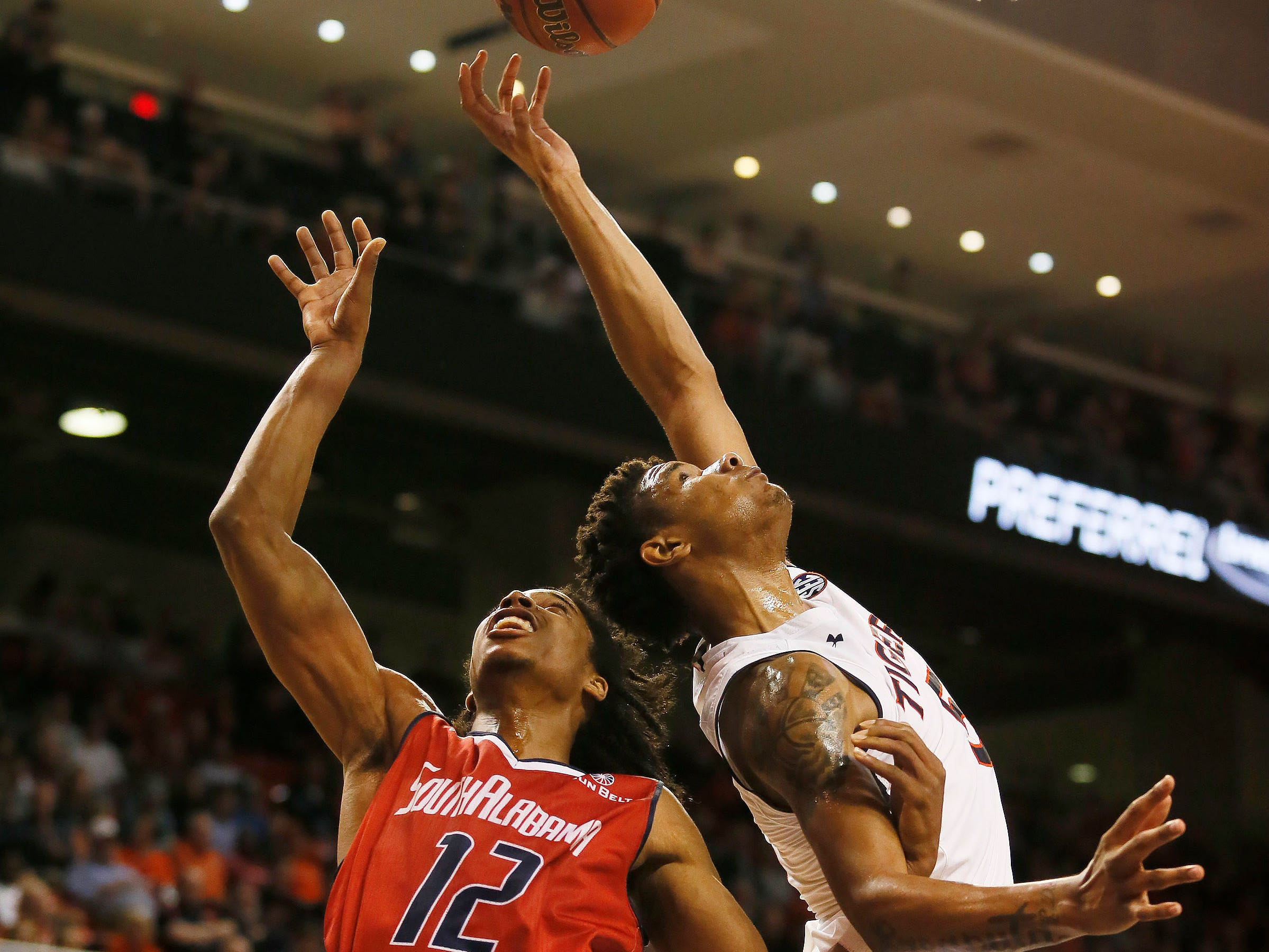 Nov 6, 2018; Auburn, AL, USA; South Alabama Jaguars forward RJ Kelly (12) battles for a rebound with Auburn Tigers guard Samir Doughty (10) during the first half at Auburn Arena. Mandatory Credit: John Reed-USA TODAY Sports
