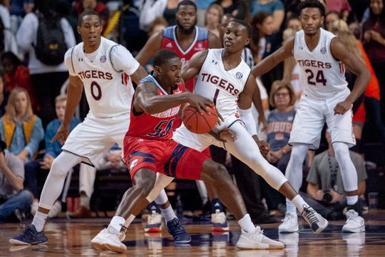 Auburn guard Jared Harper (1) defends against South Alabama guard John Pettway (50) during the first half of an NCAA college basketball game, Tuesday, Nov. 6, 2018, in Auburn, Ala.
