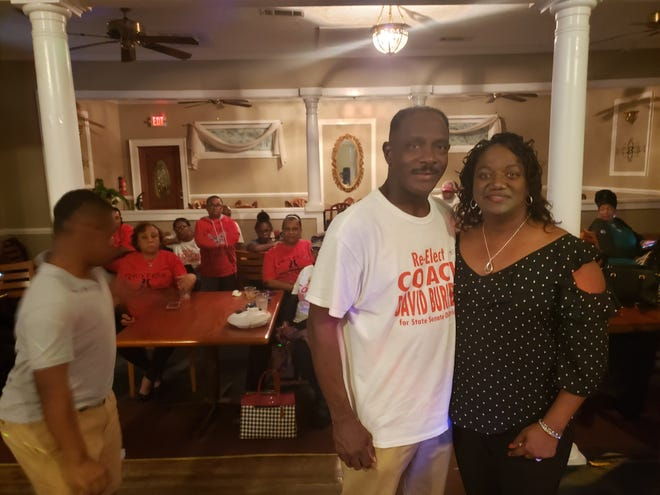 Sen. David Burkette poses for a photo with his wife, Linda, after learning that he had won Senate District 26.