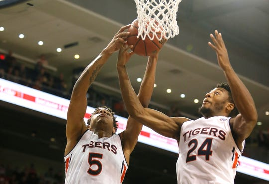 Auburn forwards Chuma Okeke (5) and Anfernee McLemore (24) battle for a rebound against South Alabama at Auburn Arena on Nov. 6, 2018.