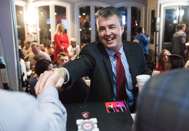 Republican attorney general candidate Steve Marshall greets supporters at Moe's Original Bar B Que in Montgomery, Ala., on Tuesday, Nov. 6, 2018.