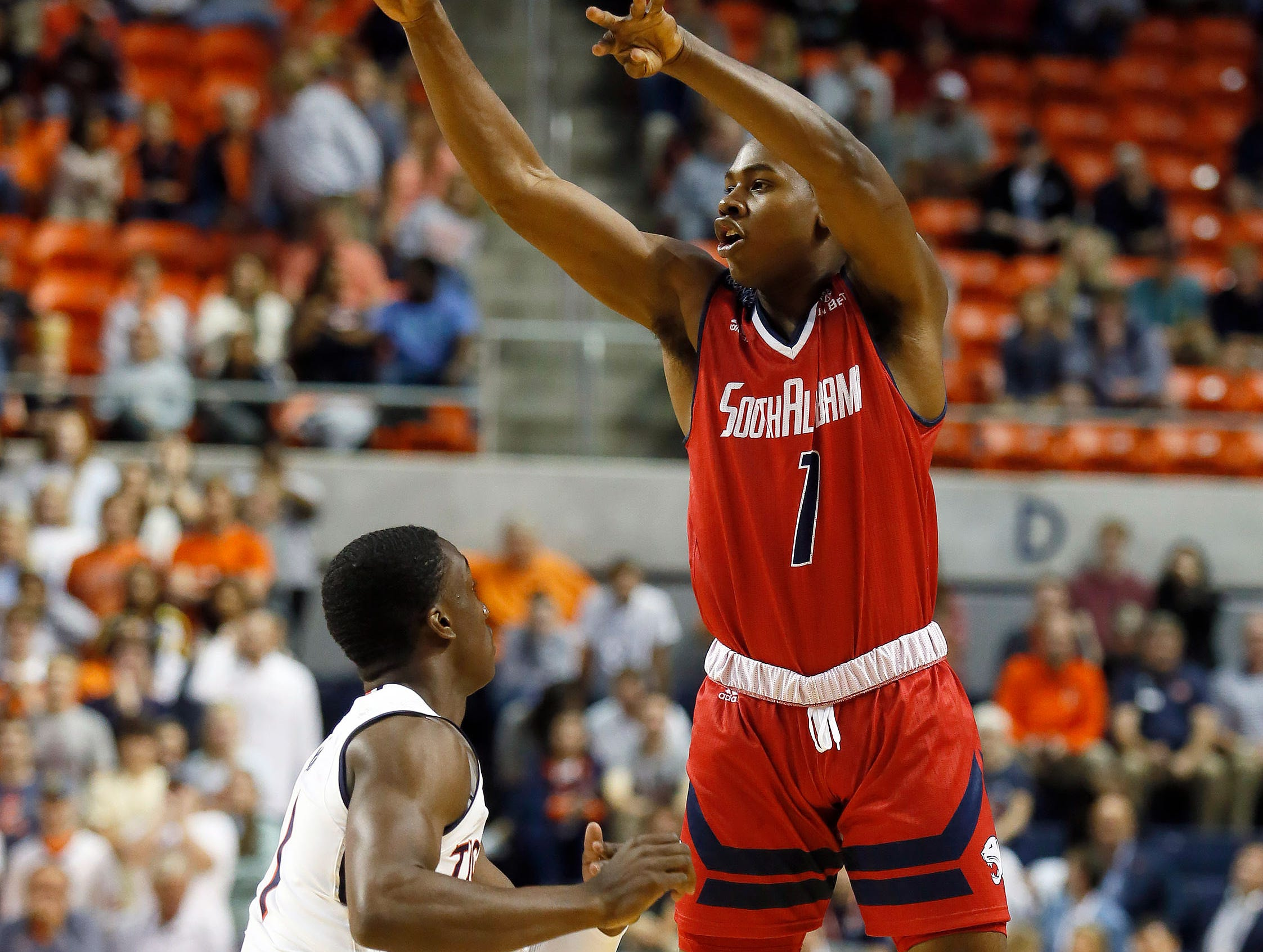 Nov 6, 2018; Auburn, AL, USA; South Alabama Jaguars guard Her BcGee (1) makes a pass over Auburn Tigers guard Jared Harper (1) during the first half at Auburn Arena. Mandatory Credit: John Reed-USA TODAY Sports