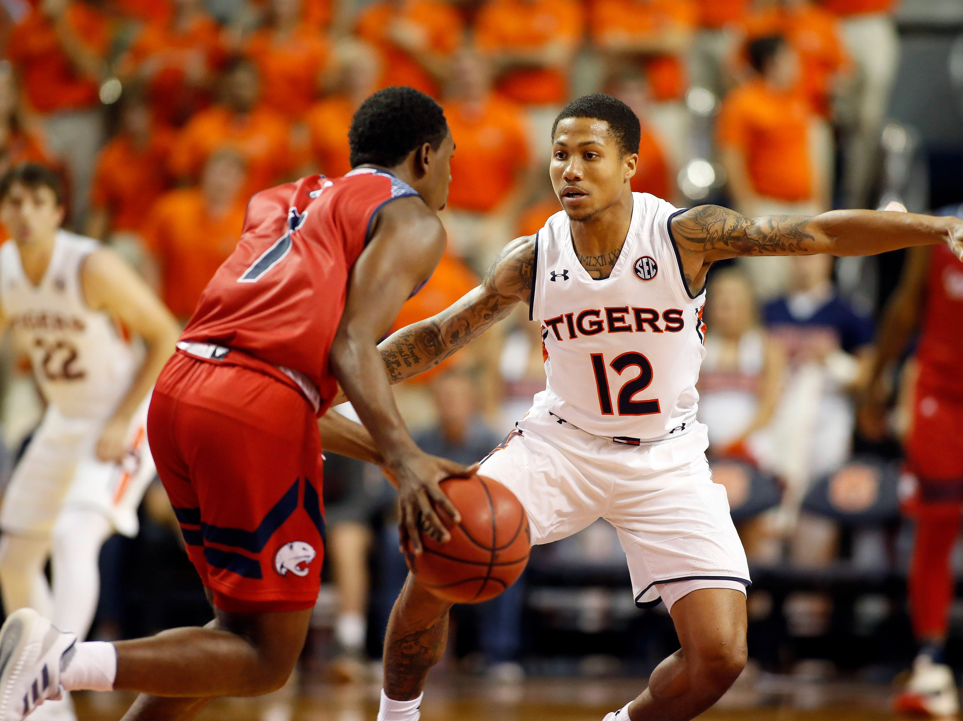 Nov 6, 2018; Auburn, AL, USA; Auburn Tigers guard J'Von McCormick (12) pressures South Alabama Jaguars guard Herb McGee during the second half at Auburn Arena. Mandatory Credit: John Reed-USA TODAY Sports