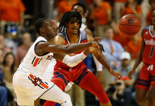 Nov 6, 2018; Auburn, AL, USA; Auburn Tigers guard Jared Harper (1) makes a pass against the South Alabama Jaguars during the first half at Auburn Arena. Mandatory Credit: John Reed-USA TODAY Sports