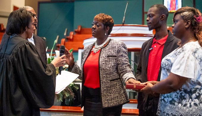 Representative Tashina Morris is sworn in as a state representative at Freewill Baptist Church in Montgomery, Ala., on Wednesday November 7, 2018. Morris is Montgomery's first black female legislator.