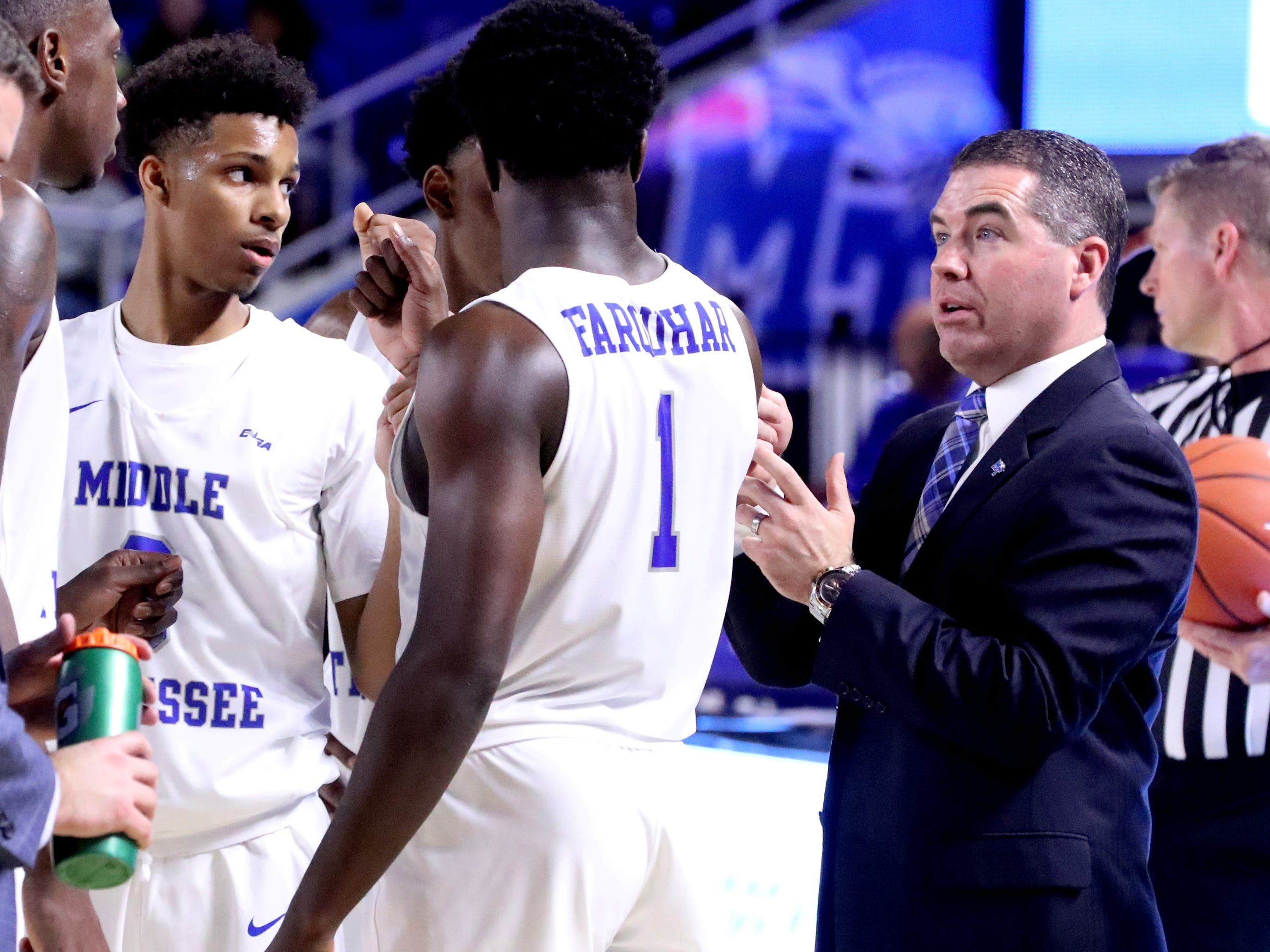 MTSU's head coach Nick McDevitt  talks with players during a break in the game against Lees-McRae on Tuesday, Nov. 6, 2018.