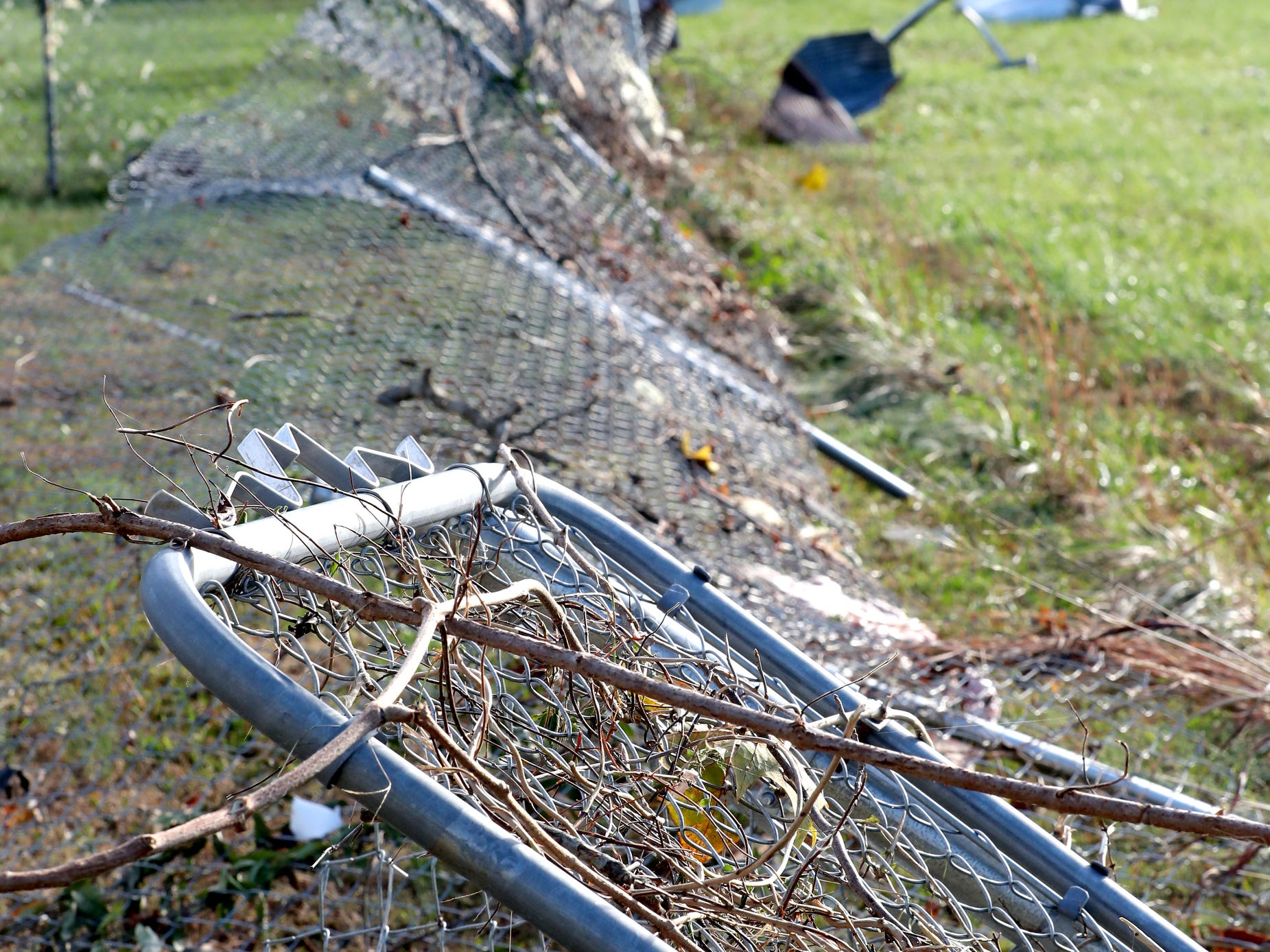 A chain link fence was knocked down by a tornado at the home of Hank and Ava Jordan, along Rock Springs Midland Road in Christiana, Tenn. on Tuesday, Nov. 6, 2018.