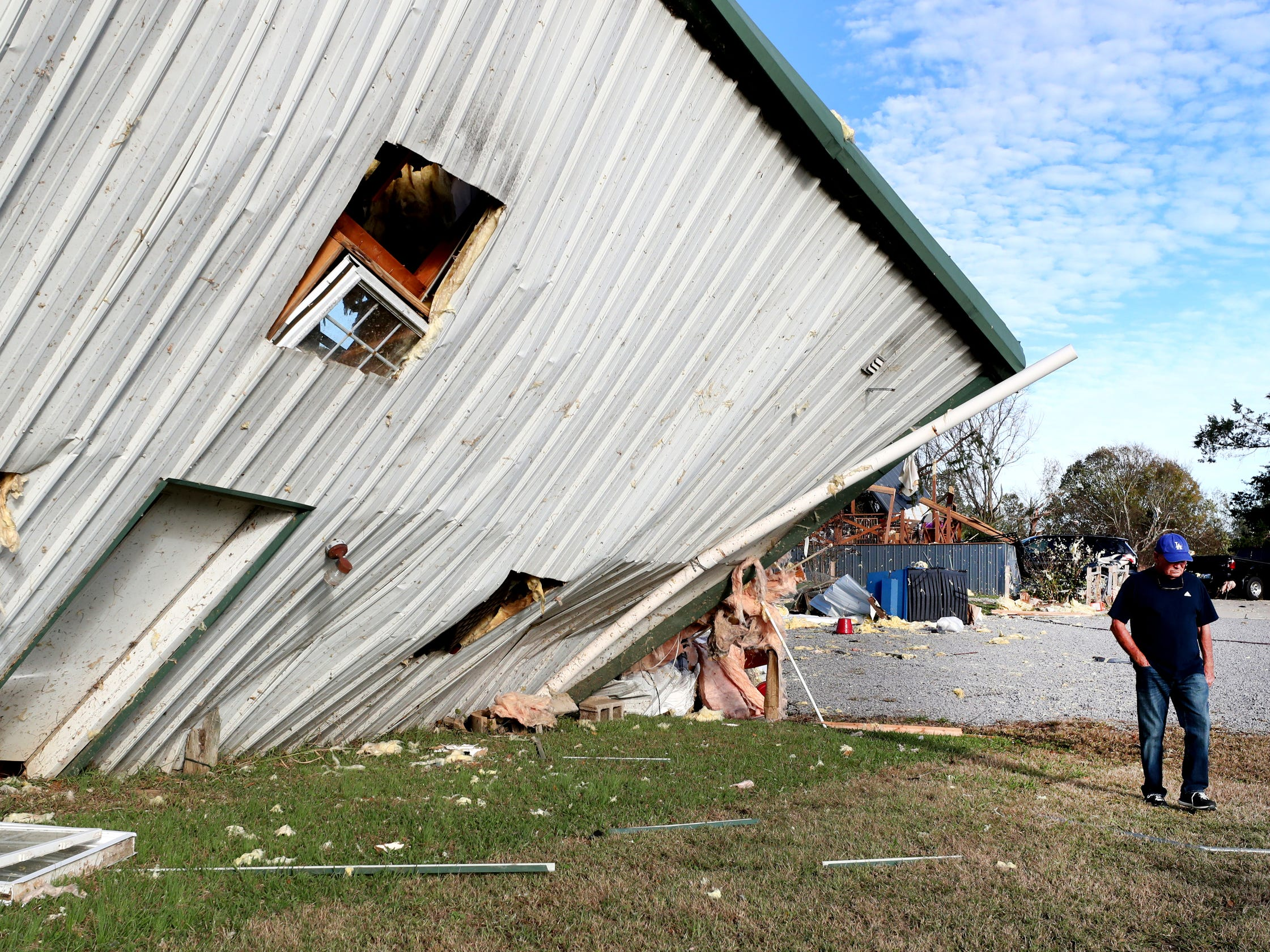 Billy Grimes Sr. shows off tornado damage to the property of his friends Hank and Ava Jordan at the Jordan home along Rock Springs Midland Road in Christiana, Tenn. on Tuesday, Nov. 6, 2018.