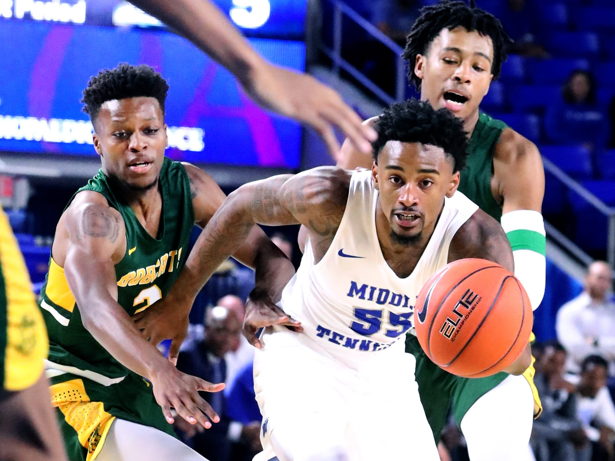 MTSU's Antonio Green (55) takes the ball down the court  as Lees-McRae's Quay Kimble (2) guards him on Tuesday, Nov. 6, 2018.