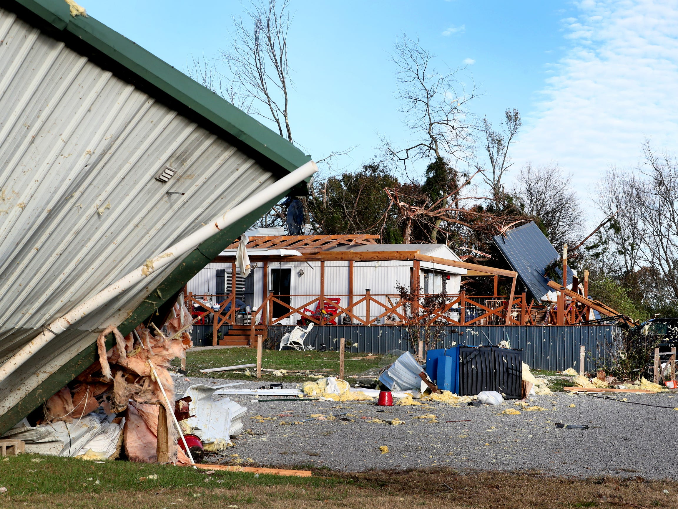 Tornado damage can be seen to the the home and work shed of Hank and Ava Jordan along Rock Springs Midland Road in Christiana, Tenn. on Tuesday, Nov. 6, 2018.
