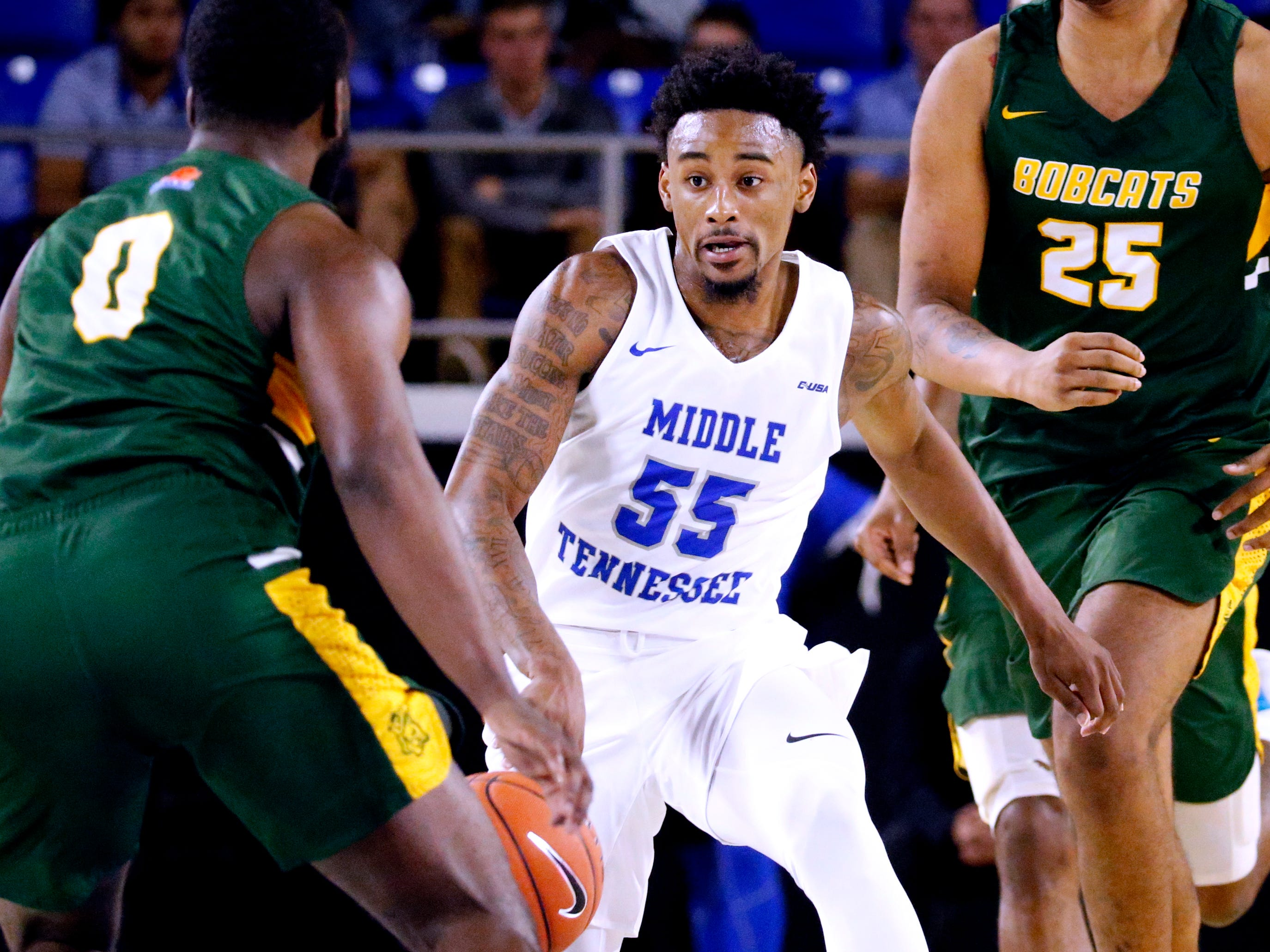 MTSU's Antonio Green (55) brings the ball down the court as Lees-McRae's Mike Lee Jr. (0) guards him on Tuesday, Nov. 6, 2018.
