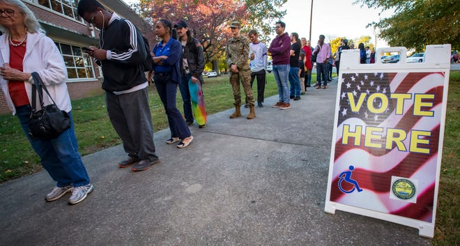 Residents wait in a long line to cast their votes at Central Magnet School on Tuesday afternoon.
