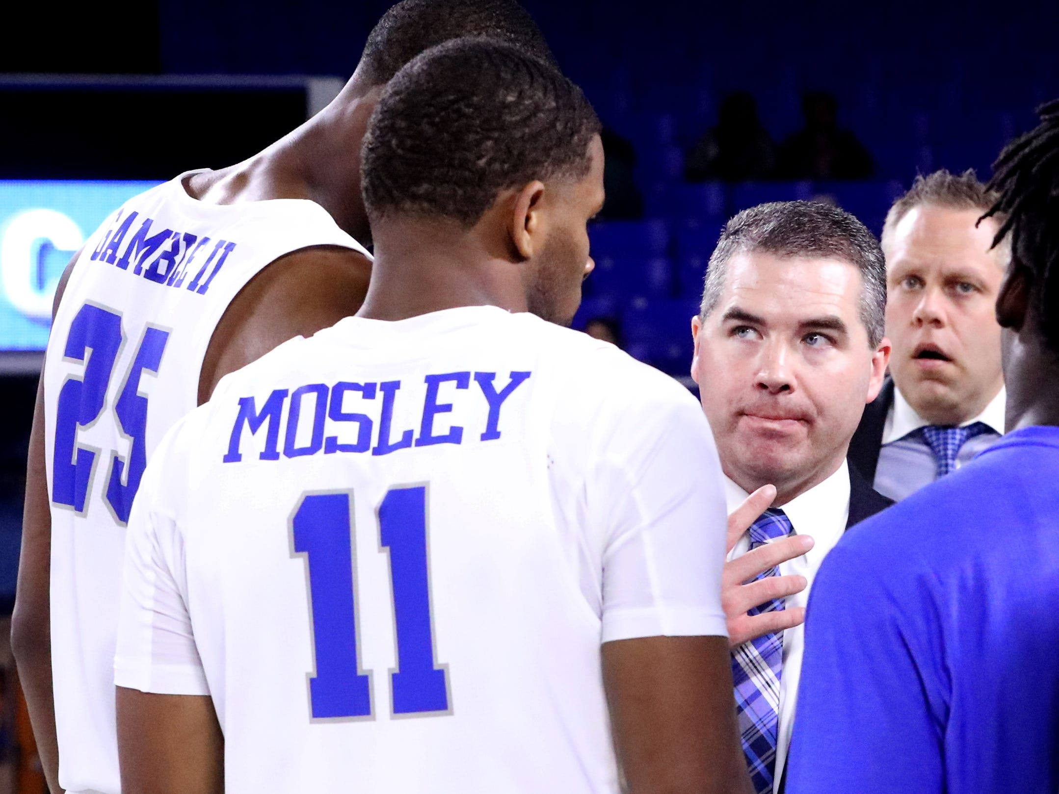 MTSU's head coach Nick McDevitt meets with his players on the court after defeating Lees-McRae  Lees-McRae on Tuesday, Nov. 6, 2018.