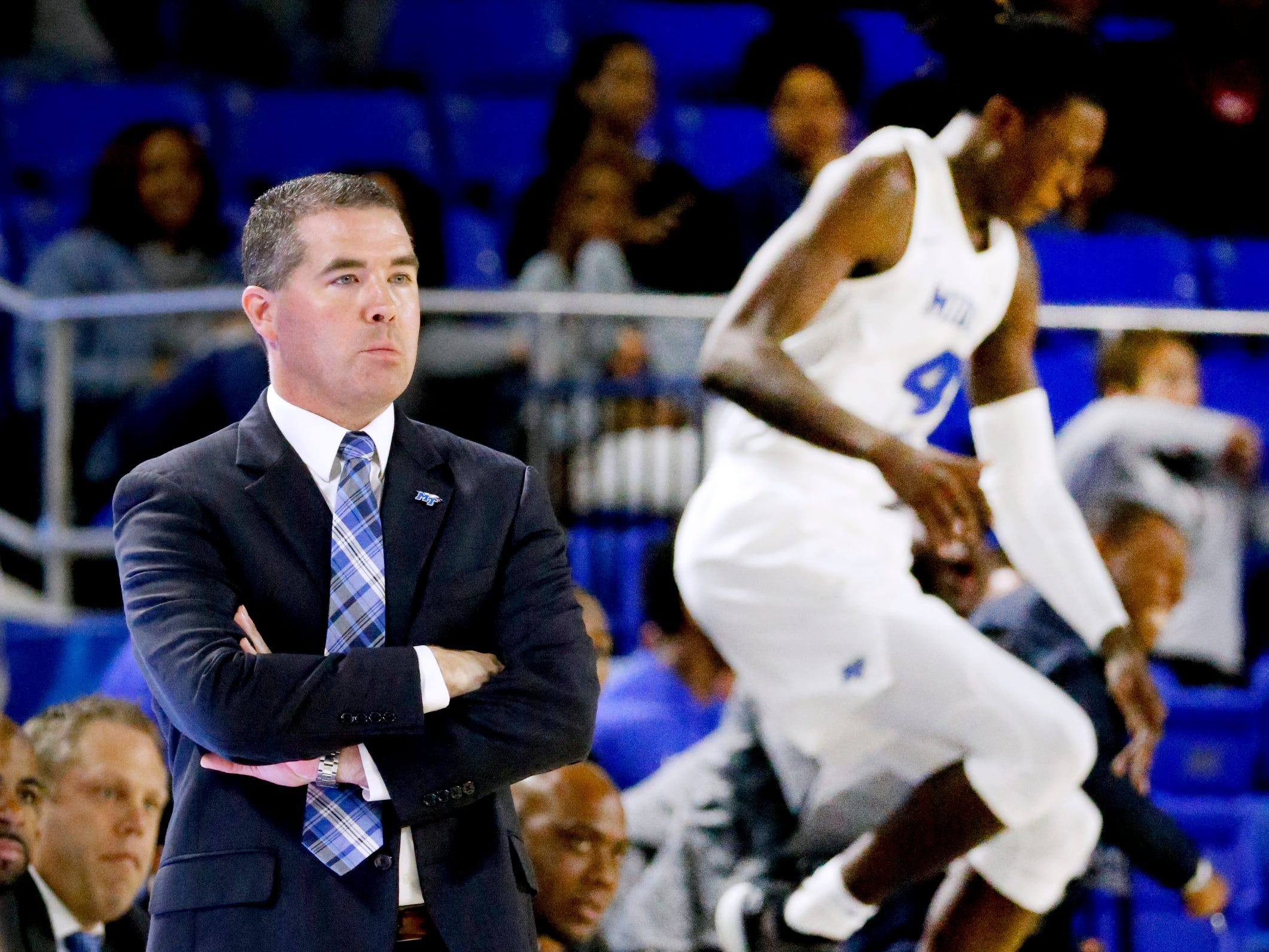 MTSU's head coach Nick McDevitt reacts after they score against Lees-McRae as MTSU's James Hawthorne (4) reacts in the background on the sidelines during the opening game of the season, on Tuesday, Nov. 6, 2018.