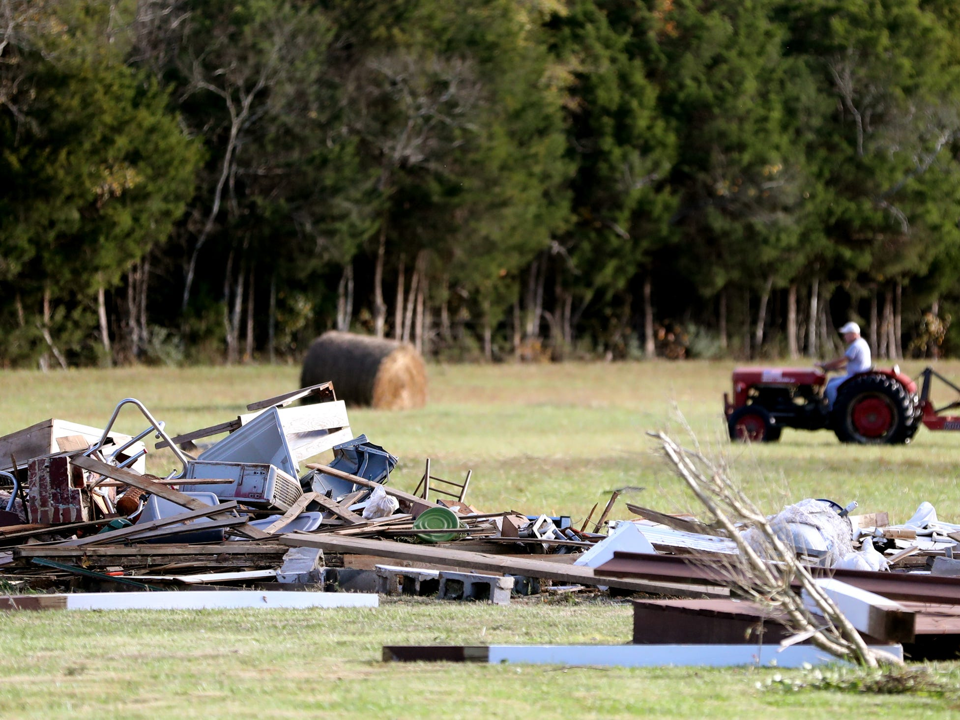 Tornado damage and cleanup efforts along Rpck Springs Midland Road following a tornado that hit the area overnight in Christiana, Tenn. on Tuesday, Nov. 6, 2018.